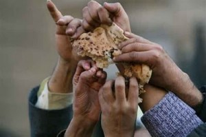 Egyptian demonstrators sharing bread during the Arab Spring 2011.