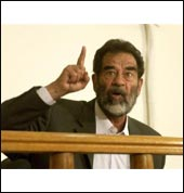Saddam Hussein on trial.