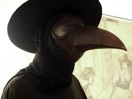 Nostradamus' Hallowween costume, the leather bird mask,hat and cape of a plague doctor.