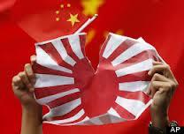 ChinaFlagRippedJapaneseFlag