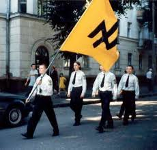 "Members of Svoboda, a Ukrainian euphemism. Their former name was the ""National Socialist"" Ukranian Party. Hitler's party was also called ""National Socialist"", meaning, a nationalist political system based on race identity."