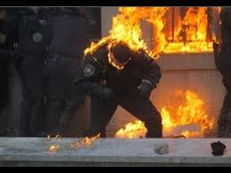 Svoboda and Right Sector thugs firebombing Ukrainian cops.