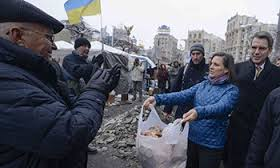 "Victoria Nuland's ""Feed a Fascist"" meals on Maidan Wheels program. All seriousness aside, Nuland passed out bread to Maidan opposition demonstrators, December 2013."