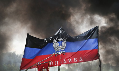 Smoke rises around the flag of the self-proclaimed Donetsk republic