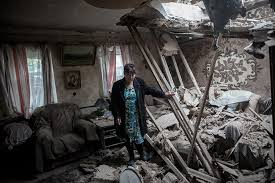 Civilians in the ruins left by months of Ukrainian terror shelling of Eastern Ukrainian cities.