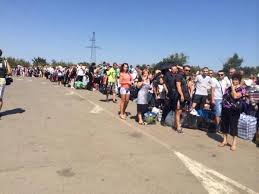 Ukrainian Russian refugees crossing into Russia.