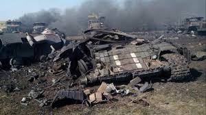 The anti-Kiev forces document their successes, such as this Ukrainian armored column destroyed by their Grad missile launching artillery in July 2014.
