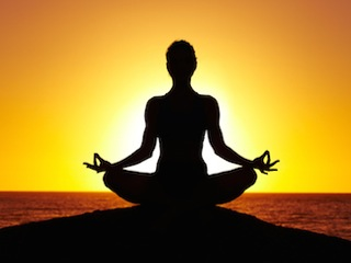 Meditator-golden sunset pose
