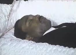 King lying in state in his coffin.