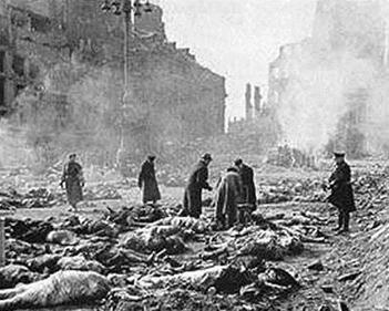 The aftermath of the Dresden allied fire bombing. Bodies are being laid out in preparation for being put on large funeral pyres made of railroad ties.