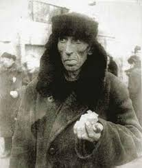 A citizen of Leningrad during the 900-day siege. He holds his starvation ration--his one meal for the day, just a handlful of bread mixed with wallpaper glue. America lost 400,000 to the war. Leningrad lost 1.5 million to the siege.