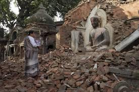 NepalQuake-BuddhaStatueSurvivesRuins