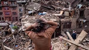 NepalQuakeRuinsManHandsonHead