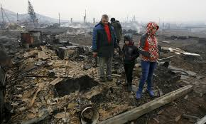 Homeless Russian villagers surveying the devastation.