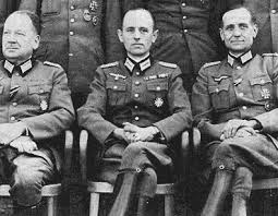 "Stephan Bandera (center), father of the Ukrainian nation"" so promote the new Kiev regime since 2014, yet he is one of the most notorious Nazi collaborators of the Second World War. Here he is dressed in his German officer's uniform."