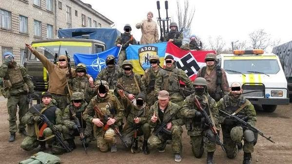 Ukrianian Azov Militiamen brazenly displaying their Nazi regalia.