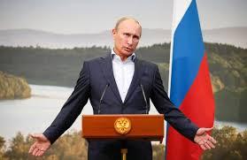 PutinArmsstretchedPodium