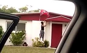 Young black kids cellphone filming themselves stealing Confederate flags from private homes.