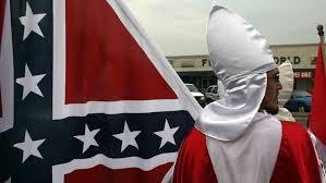 KKKmanwithConfederateFlag