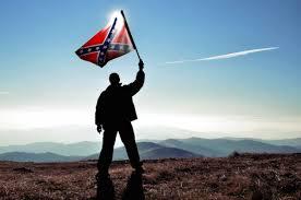 ManConfederateFlagRaisedAgainstSun