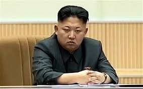 KimJongUnSittingHandsfoldedSerious