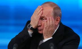 PutinHandsHidingFace