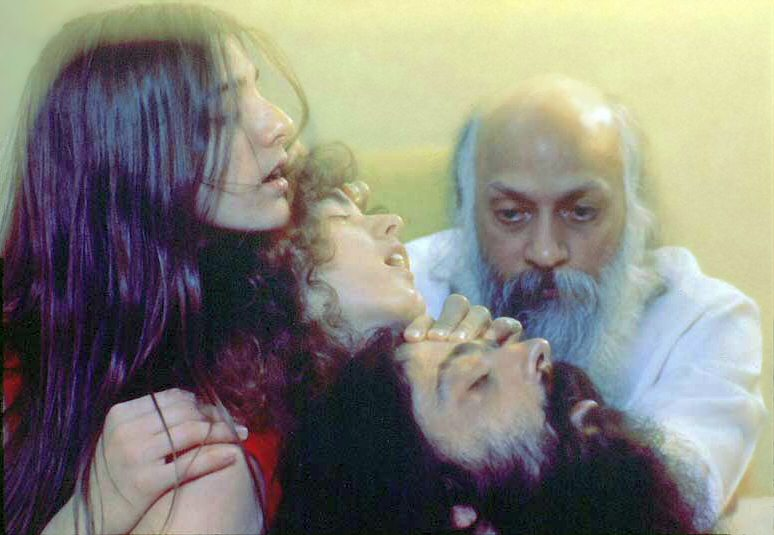 Osho giving energy Darshan.
