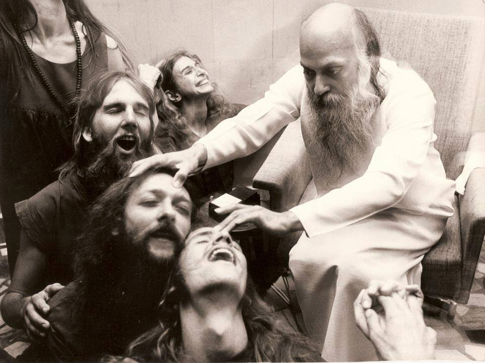 Osho giving energy darshan in Pune, India in the 1970s.