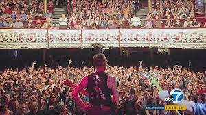 Lead singer of the Eagles of Metal Death with cheering audience just minutes before the attack at the Bataclan.