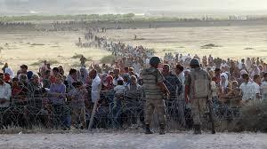 SyriansWaitingtoCrossTurkishBorder
