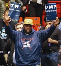 TrumpSignRippedinTwoBlackProtester