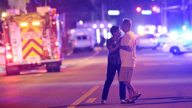 OrlandoShooting-coupleinPoliceLights