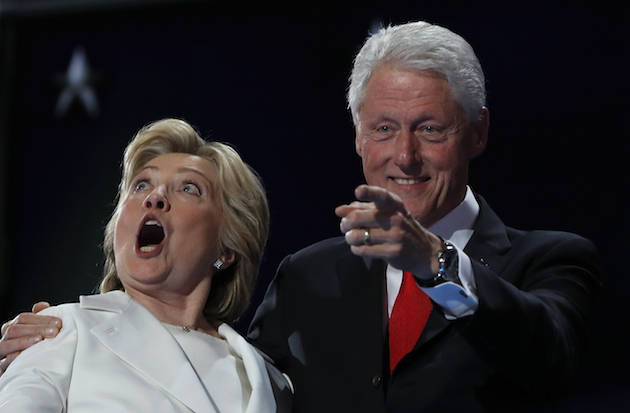 Democratic presidential nominee Hillary Clinton and Former President Bill Clinton react as balloons fall during the final day of the Democratic National Convention in Philadelphia, Thursday, July 28, 2016. (AP Photo/Carolyn Kaster)