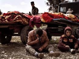 Mosul-CartsWDeadCryingManStunnedChild