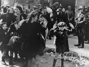 A Jewish child with family being taken prisoner in the Warsaw Ghetto Uprising 1944 by Nazi German soldiers.