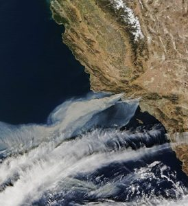 Satellite image from the Terra satellite of the smoke from the Thomas Fire in Ventura County, on December 5, along with the smoke from two other smaller fires, in Southern California.