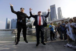 Kim and Trump doubles jump for joy in Singapore. AP Poto: Wong Maye-E.