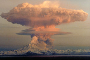 Atomic attack on Mt. Redoubt in Alaska in 1970? No. Tis' a mixed metaphor for our mixed up future where two threats may extinguish the human race: carbon released by humans added to natural releases such as volcanic eruptions as one example, lead to global warming. Compared to what the earth releases each year it is quite small, but it is like the straw that broke the back of the climate's balancing act. That this eruption forms an almost perfect hydrogen bomb mushroom alludes to the other threat to human existence. At no time, even in the last Cold War are we moving so perilously close to a thermonuclear war than now, so says my Oracle.