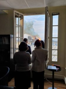 French Government workers peer out their office window at the fire.