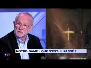 Benjamin Mouton on Pujadas 24Heures, 16 April 2019 with photo of a fireman's light illuminating the interior of Notre Dame during the peak of the fire.