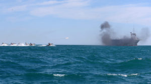 IRGC assault boats doing fire training on dummy US carrier. Source: FARS News, Hamed Jafarnejad, 2015.