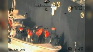 The color footage taken most likely by a US Navy drone of military attired men without insignia or flying a flag returning to detach a dud magnetic Limpet mine from the Kokuka Courageous after it was abandoned by its crew. Source: US Navy.