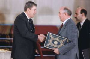 President Reagan and Soviet General Secretary Gorbachev shake hands after signing INF Treaty ratification in the Grand Kremlin Palace during the Moscow Summit. 1 June 1988.