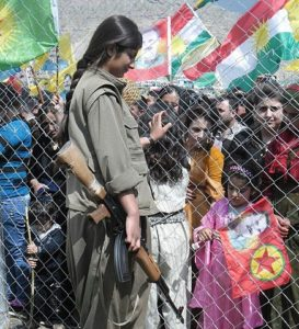 Kurdish woman PKK guerilla at the Newroz celebration in Qandil. © Creative Commons.