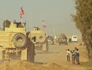 US armored personnel carriers in retreat south from the Turkish-Syrian border.
