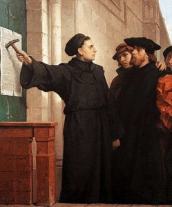 Martin Luther hammers his 95 theses to the door.