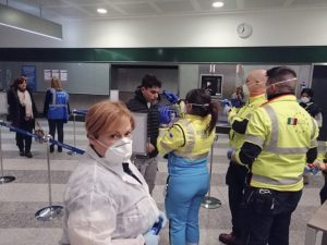 5 February 2020, Italian police and medics screening airline passengers returning from China at Milan's Malpensa International Airport.