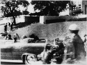 The moment Kennedy was killed by a sniper hiding this the wooded copse of the Grassy Knoll.
