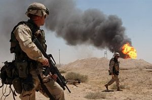 320px-US_Navy_U.S._Army_Sgt._guard_burning_oil_well_in_the_Rumaylah_IRAQ