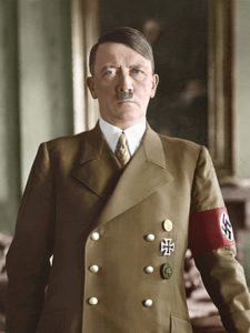 Adolf Hitler, 1938, cropped and colorized from the original: Bundesarchiv, Bild 183-H1216-0500-002 / CC-BY-SA, © Creative Commons.